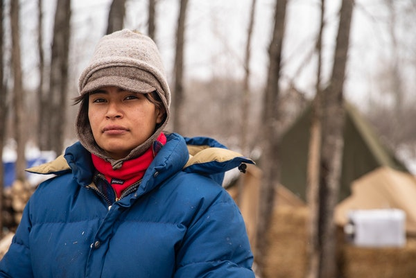 Alex Golden-Wolf, who is Ojibwe, quit her restaurant jobs in the Duluth area to move to Camp Migizi, near Cloquet, to protest Line 3.