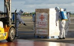 The first batch of Sinovac vaccine from China is sanitized as it arrives at the Villamor Air Base in Manila, Philippines on Sunday Feb. 28, 2021. It�
