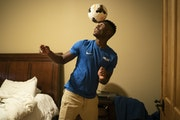 "Patrick Weah, a newly signed professional soccer player at age 17, sharpened his skills with a soccer ball in his room in Maple Grove. ""This is what"