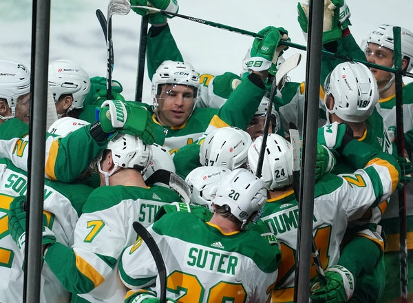 Wild defenseman Matt Dumba (24) capped Hockey Day Minnesota with a nifty overtime winner, after which he was mobbed by his teammates.