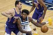 Wolves guard Anthony Edwards drove against ther Suns' Dario Saric in the first quarter Sunday.
