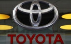 FILE - In this Sept. 20, 2017, file photo the Toyota logo is displayed at their shop on the Champs Elysees Avenue in Paris. The U.S. government is inv