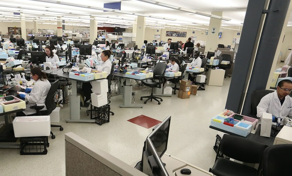 Lab workers log in specimen samples at the Mayo Clinic Superior Drive facility in March 2020 in Rochester.  (Staff photo by David Joles/david.joles@st