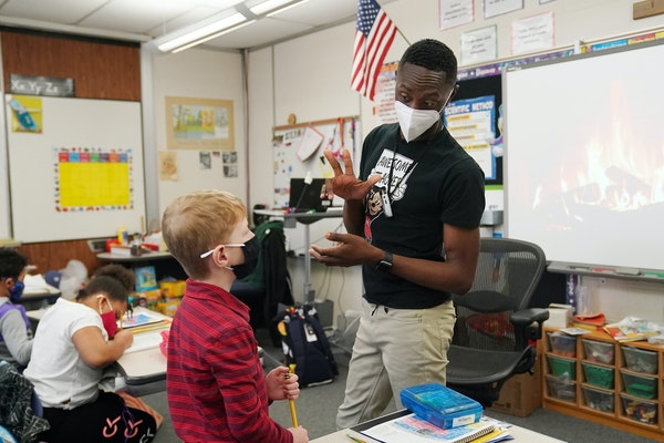 Shad Williams, a second grade teacher at the School of Engineering and Arts, talked with one of his students as they worked through a lesson. ANTHONY