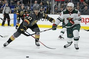 Vegas Golden Knights left wing Max Pacioretty (67) and Minnesota Wild defenseman Matt Dumba (24) vie for the puck during the second period of an NHL h