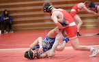 Lakeville North junior Jore Volk took down St. Michael-Albertville's Landon Robideau in a match between the No. 1 and No. 2 wrestlers in Class 3A at