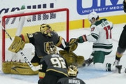 Minnesota Wild left wing Marcus Foligno (17) scores on Vegas Golden Knights goaltender Marc-Andre Fleury (29) during the second period of an NHL hocke