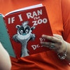 """In this Sept. 24, 2013, file photo, Courtney Keating, education coordinator of The Literacy Center in Evansville, Ind., reads """"If I Ran the Zoo,"""""""