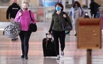 To prevent the spread of Covid-19, travelers wear masks at Love Field Tuesday, March 2, 2021, in Dallas.