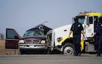 Law enforcement officers work at the scene of a deadly crash in Holtville, Calif., on Tuesday, March 2, 2021. Authorities say a semi-truck crashed int