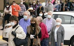 People waited in line Feb. 4 to receive a COVID-19 vaccination at Methodist Hospital in the Oak Cliff section of Dallas.