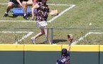 Twins outfielder Alex Kirilloff can't reach a two-run home run hit by the Braves' Travis d'Arnaud during the first inning of a spring training b