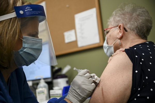 Nurse Linda Nordquist administered a dose of the Pfizer-BioNTech COVID-19 vaccine to LeAnn Schuerman, 78, of Brooklyn Park, on Feb. 2 at Minnetonka Me