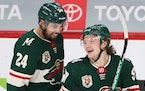 Rookie winger Kirill Kaprizov (right, with defenseman Matt Dumba) is the Wild's leading scorer and has impressed teammates and fans with his dazzlin