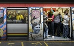 Caracas commute: Subway riders wore masks Tuesday in Caracas, Venezuela.  The nation said it has enough vaccine supplies to inoculate 38% of its popul
