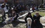 People gather at the main square after an earthquake in Larissa city, central Greece, Wednesday, March 3, 2021. The earthquake with a preliminary magn