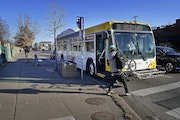 A rider with a bicycle pulled the bike off a rack on a Metro Transit Route 21 bus in Minneapolis in December.