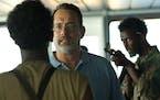 """Tom Hanks, center, stars in """"Captain Phillips."""""""