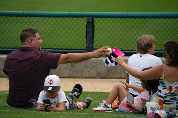 Fans watched the Twins' spring opener on Sunday in Fort Myers, Fla.