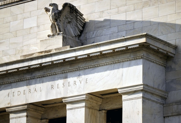 The Federal Reserve system, above in Washington, D.C., has stood by for decades as racial inequality persisted, the writers say. It's addressing the