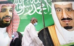 A banner showing Saudi King Salman, right, and Crown Prince Mohammed bin Salman hangs outside a mall in Jiddah, Saudi Arabia.