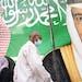 A banner showing Saudi King Salman, right, and Crown Prince Mohammed bin Salman hangs outside a mall in Jiddah, Saudi Arabia.