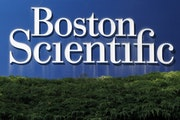 A Boston Scientific Corporation logo is displayed in Massachusetts in July 2010. (AP file photo.)  ORG XMIT: MIN2101211455540123