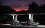 In this Wednesday, Sept. 30, 2015, photo, motorists get gas at a station in Sacramento, Calif. A Northern California city has become what's believed