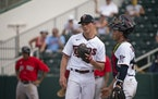 Twins catcher Ben Rortvedt visited with relief pitcher Cody Stashak during a game on Feb. 28.