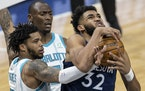 Minnesota Timberwolves' Karl-Anthony Towns (32) was fouled by Miles Bridges (0) of the Charlotte Hornets dunked the ball in the third quarter.