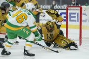 Vegas Golden Knights goaltender Marc-Andre Fleury blocks a shot by Wild defenseman Jared Spurgeon during the first period