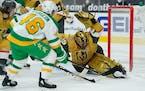 Vegas Golden Knights goaltender Marc-Andre Fleury blocks a shot by Wild defenseman Jared Spurgeon during the first period
