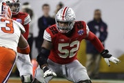 FILE - Ohio State offensive lineman Wyatt Davis (52) is shown during the first half of the Fiesta Bowl NCAA college football game against Clemson, Sat