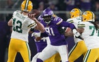 Packers quarterback Aaron Rodgers (12) threw under pressure from Vikings defensive end Stephen Weatherly (91) on Dec. 23, 2019.