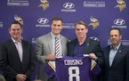 Minnesota Vikings Head Coach Mike Zimmer, left, stood next to Kirk Cousins, along with general manager Rick Spielman and co-owner Mark Wilf as he offi
