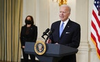 President Joe Biden, accompanied by Vice President Kamala Harris, speaks about efforts to combat COVID-19, in the State Dining Room of the White House