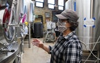 Deb Loch, master brewer and co-owner of Urban Growler Brewing Co., took a sample from one of the tanks Wednesday afternoon.