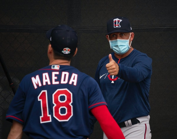 Kenta Maeda with pitching coach Wes Johnson during a bullpen session at spring training.