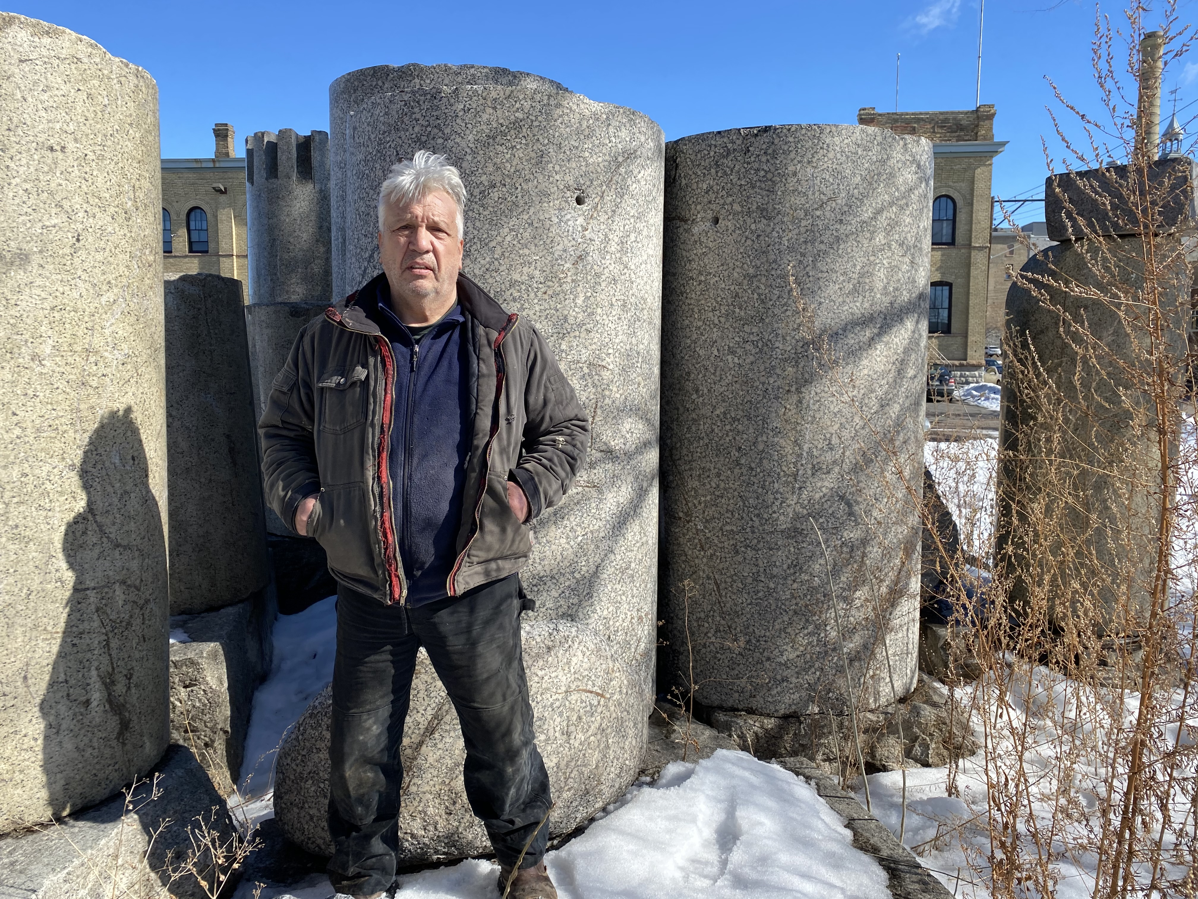 Zoran Mojsilov stands in front of the Great Northern Depot columns at his outdoor studio and sculpture garden in Northeast Minneapolis.