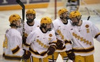 Brannon McManus (7) celebrated a goal with his teammates on Jan. 21 against Arizona State.