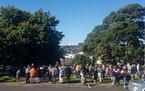 People gather on high ground in Whangarei, New Zealand, as a tsunami warning is issued Friday, March 5, 2021. A powerful magnitude 8.1 earthquake stru