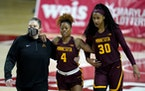 Gophers guard Jasmine Powell (4) is helped off the court on Feb. 20 at Maryland. She is not expected to play Friday at Illinois.