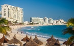 Resort hotels line the beach in Cancun, Mexico.