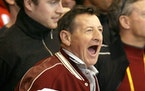 Walter Gretzky, father of Wayne Gretzky, yells encouragement from the stands at the start of a Salt Lake City Winter Olympics hockey game between Cana