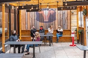 An enclosed patio at Red Cow, which serves burgers and a long list of gastropub fare.