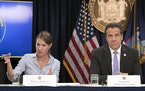FILE — In this Sept. 14, 2018 file photo, Secretary to the Governor Melissa DeRosa, is joined by New York Gov. Andrew Cuomo as she speaks to reporte