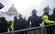 Police stood guard after holding off rioters who tried to break through a police barrier Jan. 6 at the Capitol in Washington.