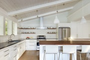 The new kitchen (top) on the walkout lower level of the split-level home is now fresh and inviting.