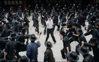 Ip Man (Dennis To), in his days as a Foshan policeman, takes on about 100 guys with axes. It's just another day at the office for The Grandmaster in