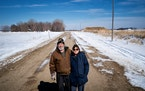 Rick and Tammy Kirkpatrick stood on 595th St. in Eden Valley. Their seven-acre home is in the wooded area on the left, and the berm that is supposed t